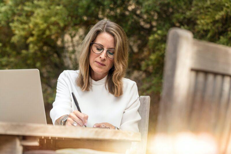 Menopause: Woman sitting outside writing