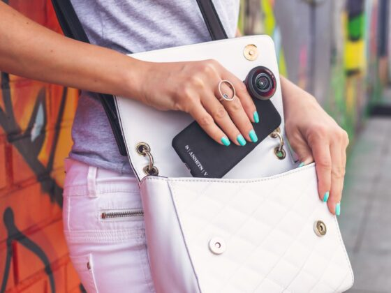 Trends: Woman putting cell phone in purse