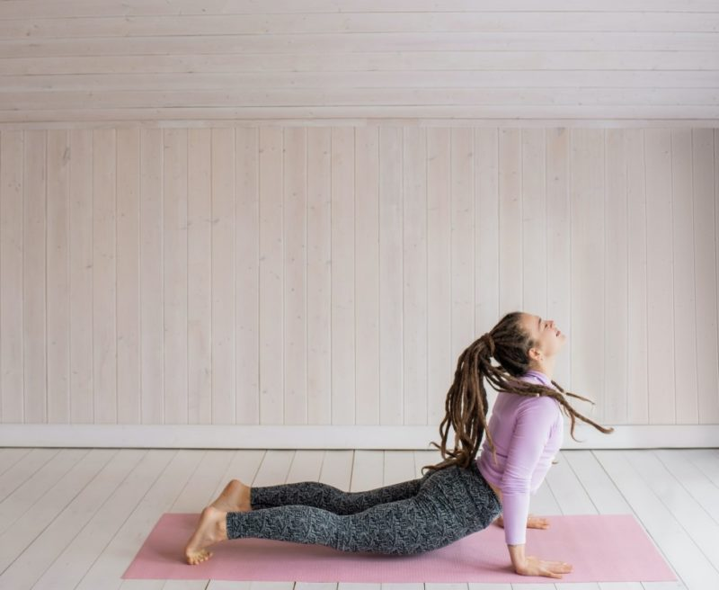 Yoga Classes: Woman posing near window