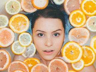 Vitamin C Serum: Woman in Spa Surrounded by Citrus