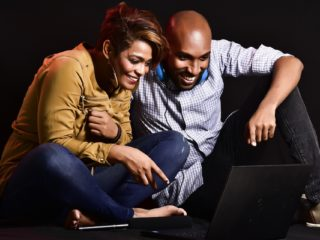 Dinner: Couple at a laptop