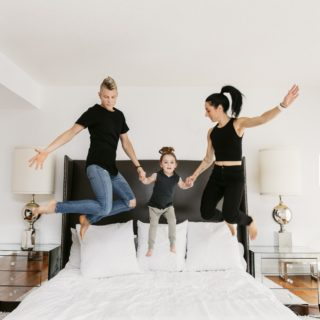 Fitness and Nutrition: Val Desjardins and family jumping on a bed