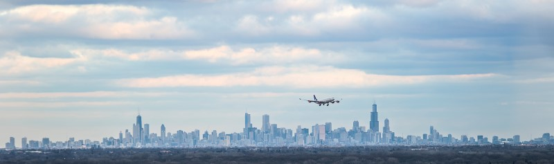 Chicago: Airplane Flying over City