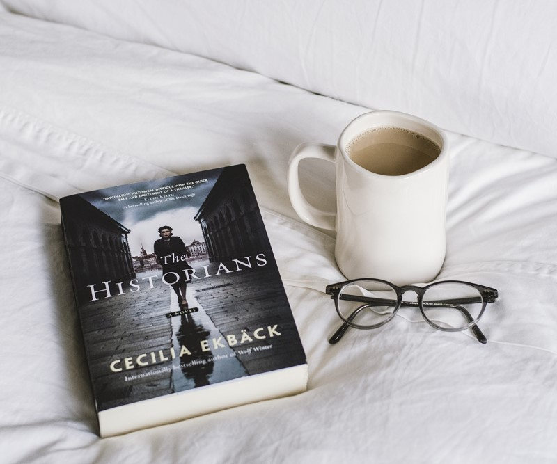 The Historians: Book on a bed