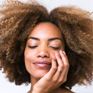 Skincare Serums: Women touching her face