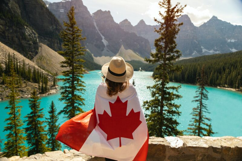 Summer 2021: Woman draped in Canadian Flag